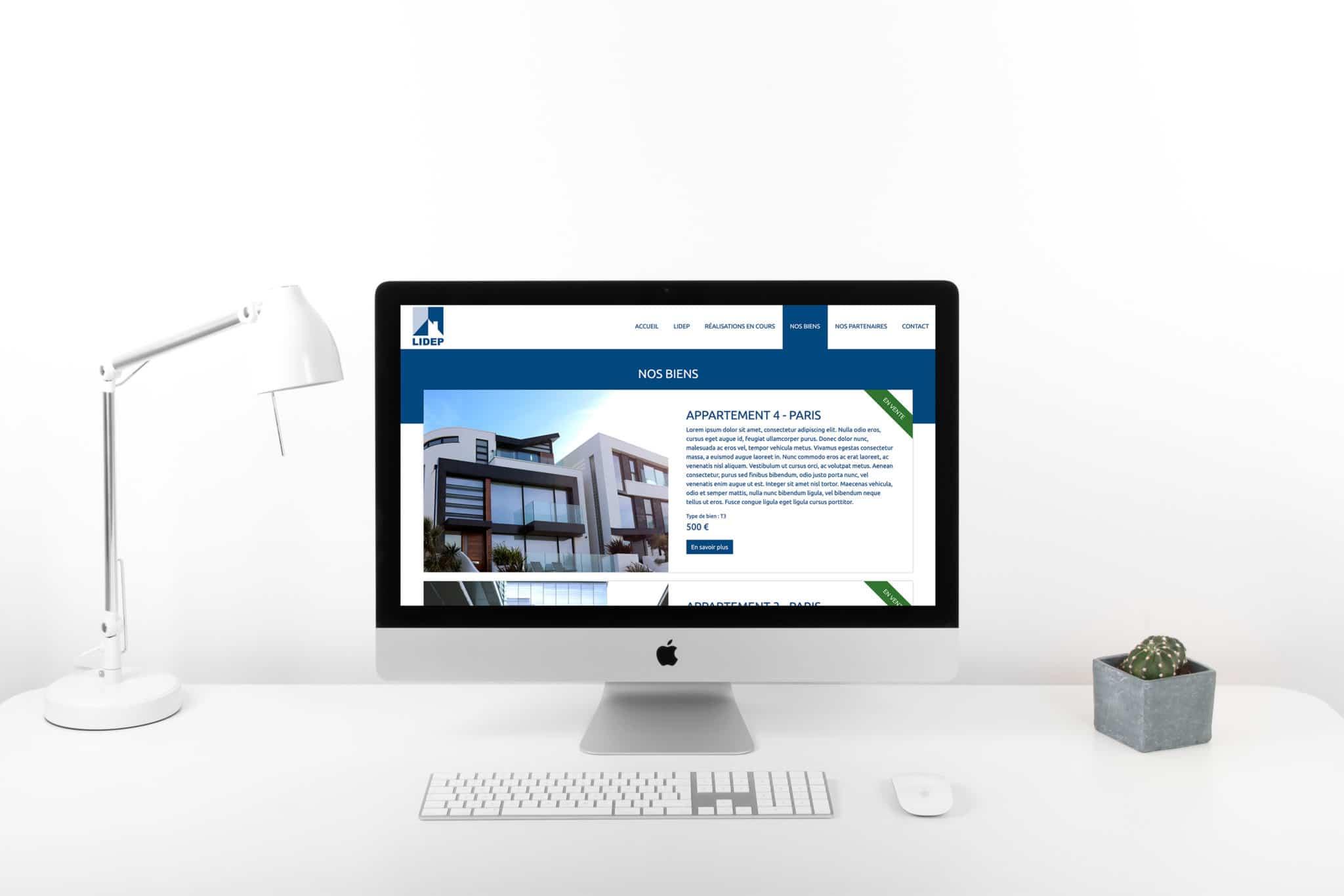 Mise en situation de la page de présentation des biens immobiliers dans un écran d'ordinateur